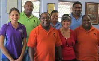 Two ADCQ Far North Qld staff with five members of the Napranum Council