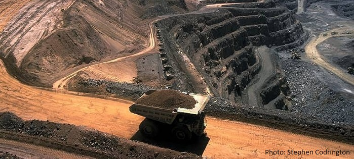 An open-cut mine with a large dump truck, to indicate the type of large resource projects covered by the discrimination provisions