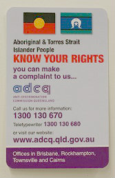 Aboriginal and Torres Strair Islander flags and contact details for making a complaint to the Anti-Discrimination Commission