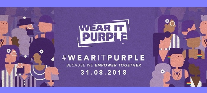 Purple cartoon figures with rainbow badges, and the words '#Wear it purple - because we empower together, 31 August 2018